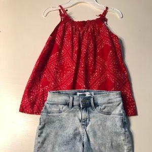 Girl's polka dot top with jean shorts.